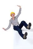 Craftswoman falling down. To the ground Stock Photos