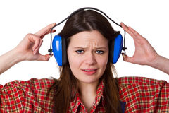 Craftswoman with hearing protection Royalty Free Stock Photo