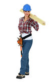 Craftswoman holding a board Royalty Free Stock Image