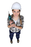 Craftswoman holding a drill. Craftswoman holding a power a battery powered drill Royalty Free Stock Photography