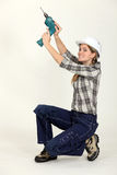 Craftswoman holding drill Stock Image