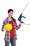 Craftswoman holding a drill Stock Image