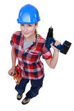 Craftswoman holding a drill Stock Photos