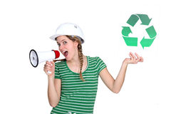 Craftswoman holding a recycling label. And talking through a megaphone Stock Photography