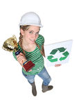 Craftswoman holding a recycling label Royalty Free Stock Photo