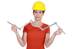 Craftswoman holding ruler Stock Photo