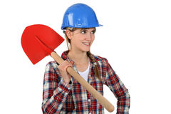 Craftswoman holding a shovel Stock Images