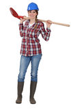 Craftswoman holding a shovel Royalty Free Stock Photos