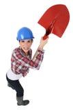 Craftswoman holding a shovel Stock Photos