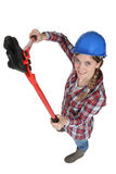 Craftswoman holding a spanner Stock Images