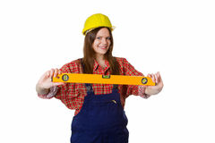 Craftswoman holding water-level. Young woman with hardhat carrying a water-level - isolated stock images