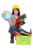 Craftswoman posing with recycling tub Royalty Free Stock Photos