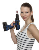 Craftswoman with a power drill Royalty Free Stock Photography