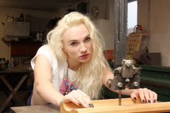 Craftswoman at power saw Royalty Free Stock Photo