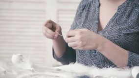 Craftswoman shows Dreamcatcher. Hobbies Crafts. Dreamcatcher: the process of creating. Master makes new Dreamcatcher in art studio. Craftswoman shows stock video
