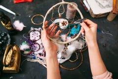 Craftswoman shows  Dreamcatcher. Stock Photo