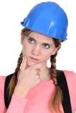 Craftswoman thinking Stock Images