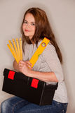Craftswoman with tools Royalty Free Stock Image