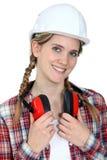 Craftswoman wearing earphones Stock Photos