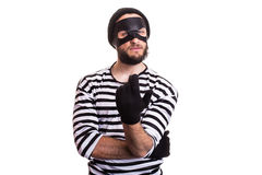 Crafty criminal inviting with hand. Portrait isolated on white background Stock Photos