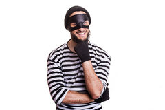 Crafty criminal smiling and thinking. Portrait isolated on white background Royalty Free Stock Image