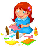 Crafty girl. Little girl making crafts from paper Royalty Free Stock Images