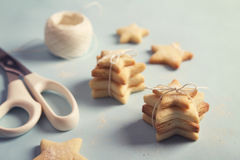 Crafty home made star shaped festive cookies horizontal Royalty Free Stock Photos