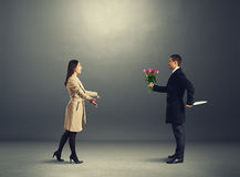 Crafty man with flowers and knife. Crafty men with flowers and knife waiting young woman Royalty Free Stock Photography
