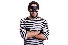 Crafty offender smiling. Crafty bandit smiling. Isolated on white background Royalty Free Stock Images