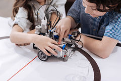 Crafty pupils using with modern technologies at school stock photos