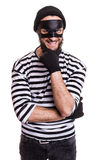 Crafty robber smiling and thinking. Portrait isolated on white background Royalty Free Stock Photo