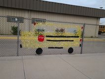 Crafty School Bus Sign. Pretty ingenious! ,Specially when kids are cooperating to create a precious unity Stock Images
