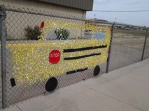 Crafty School Bus Sign. Pretty ingenious! ,Specially when kids are cooperating to create a precious unity Royalty Free Stock Image