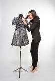 Crafty tailor. Cutting somthing from new dress Royalty Free Stock Photos