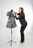 Crafty tailor. Cutting somthing from new dress Royalty Free Stock Images