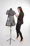 Crafty tailor. Cutting somthing from new dress Stock Photos