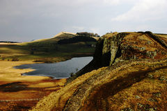Crag lough. Lake below cliff and Hadrian's wall royalty free stock photos