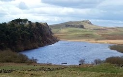 Crag Lough and Hadrians Wall. View of Crag Lough and Steel Rigg Crag at Hadrians Wall Royalty Free Stock Photo