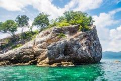 Crag rock cliff with emerald sea Stock Photo