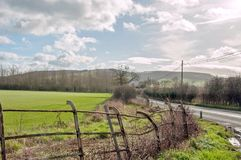 Craggy old fence in the English countryside. A craggy old metal railing fence in the English countryside of the United Kingdom Royalty Free Stock Photography