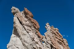 Craggy rock formations against a deep blue sky at Plaza Blanca, Abiquiu, New Mexico. Unusual, colorful rock formations at Plaza Blanca near Santa Fe, New Mexico stock images