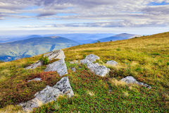 Craggy rocks from the grass on a hillside. Large craggy rocks protruding from the grass on the hillside Royalty Free Stock Photo
