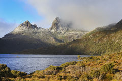 Cragle Mt Sunlight Front Rise. Australia Tasmania Cradle Mt DOve lake natural landmarks in national park with Cradle Mt peak under snow at sunrise Royalty Free Stock Image