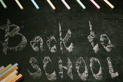 Craie avec des mots de nouveau à l'école Photo libre de droits
