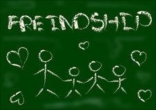 Craie de dessin d'amitié sur le conseil noir Images libres de droits