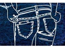 Craie de dessin sur un tissu de denim bleu-foncé Image stock
