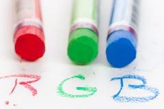 Craies en pastel de couleur avec l'inscription Image stock
