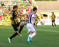 Craig Gardner battles Jarad van Schaik for the ball. Stock Images