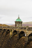 The Craig Goch reservoir and dam intake tower. Stock Photography