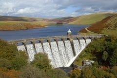 Craig Goch reservoir overflowing, Elan Valley. Craig Goch reservoir with water overflowing, Elan Valley, Wales royalty free stock image